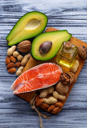 53059301 - healthy fat salmon, avocado, oil, nuts. selective focus